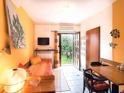 Photo for Yellow apartment with a large garden