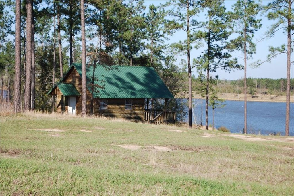 Secluded cabin overlooking private 50 acre bass fishing for Private fishing lakes