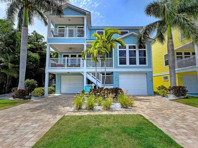Photo for HUGE PRIVATE HEATED POOL, STEPS to BEACH, ELEVATOR, Coastal Chic & Super Clean!