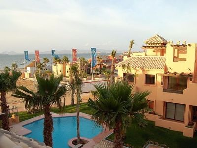Photo for Stylish split-level apartment with pool, beach and great sea views