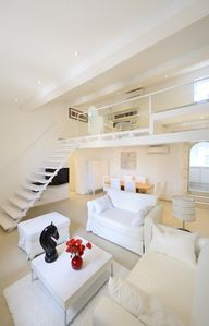 Photo for 110sqm duplex loft in listed mansion near Place du Forum