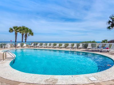 Photo for Waterfront condo w/ shared pools, sauna, tennis, & fitness center