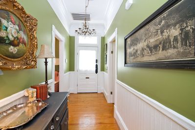 The entry hall is complete with equisite chandlier and antique artifacts.