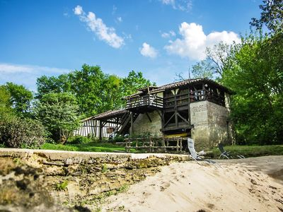 Photo for Moulin de Saint Cricq, unusual cottage by the river with swimming pool and sauna