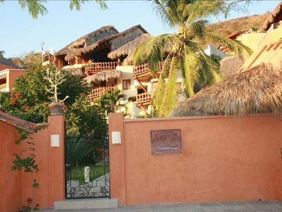 Rear gated entrance and steps to Playa la Ropa beach