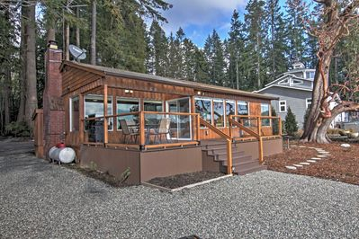 Escape to Liberty Bay shores when you stay at this waterfront house in Poulsbo.