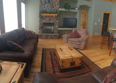 Great room, gas log fireplace, flat screen tv and new sleeper sofa and loveseat