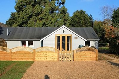 Photo for Luxury Single Storey Wooden Clad Colonial Style Cottage In Countryside Setting.