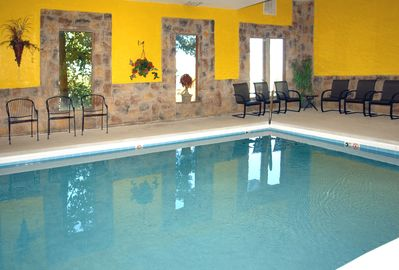 A private year round indoor  heated pool.  22' x 14.5' and up to 4 ft deep