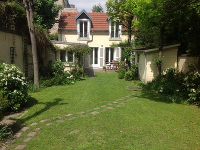 Photo for Little cottage with private garden, a gem walking from the Eiffel Tower