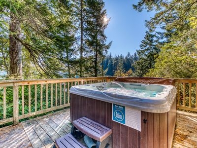 Photo for Expansive deck w/hot tub & dock on Woahink Lake. Dog-friendly!