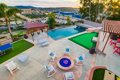 Pool, jacuzzi, slide, ping-pong, fire pit, corn-hole, and putt-putt golf holes