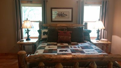 Large master bedroom with flat screen tv and ensuite w/large walkin rain shower.