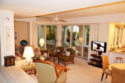 Living room with double sliding glass doors to the wrap around lanai
