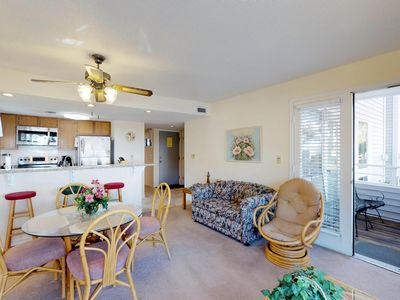 Photo for Coastal condo w/ shared pools, hot tub, sauna, tennis & more, 1 block from beach