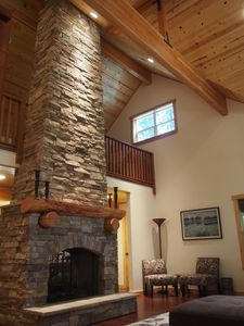 Photo for Gorgeous mountain cabin with two-story stone fireplace