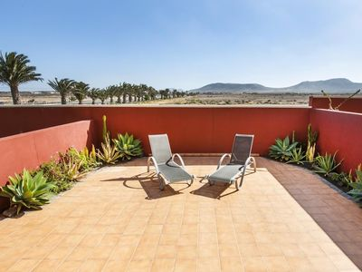 "Photo for Apartment a short walk away (270 m) from the ""Playa de El aljibe de la cueva"" in La Oliva with Garden (647203)"