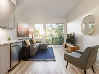 Photo for Bright 2 BR Downtown Modern Condo w/ King Bed! Parking!