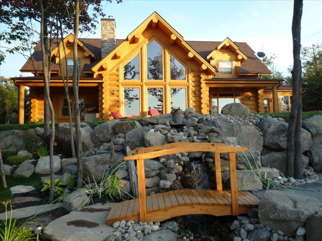 Luxury log home in the laurentians mille isles for Laurentian mountains cabin rental