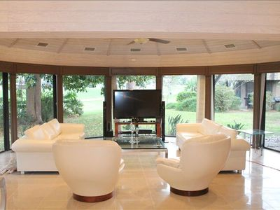 Octagonal living room with 55 inch flat screen television