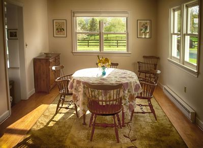 Dining room with mountain and pasture views