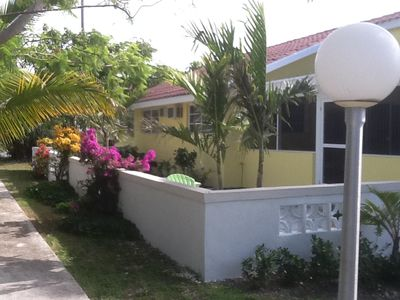Photo for Charming 2 bedroom, 2 bath, Bahamian Bungalow, Screened in Lanai, Private Garden