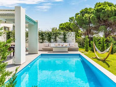 Photo for Sandy beaches, shops and restaurants within walking distance  great for beach lovers, super smart modern villa.