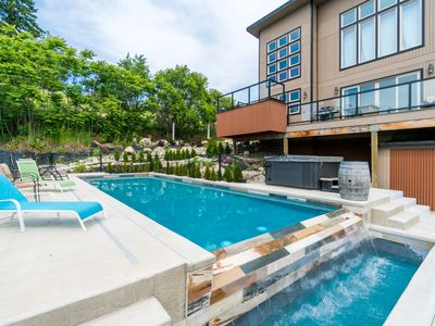 Photo for Has it all: private pool, hot tub, game room, lake views, and walkable to town!