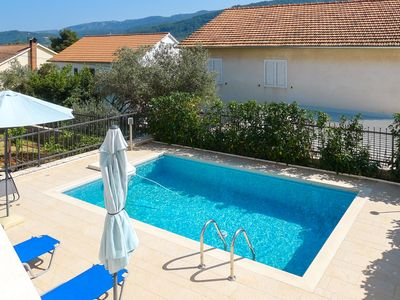 Photo for This 3-bedroom villa for up to 8 guests is located in Stari Grad / Starigrad and has a private swimm