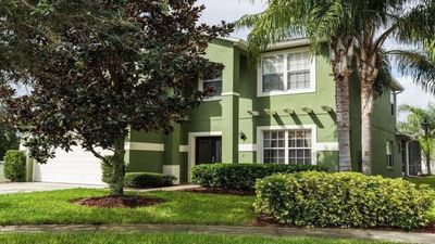 Photo for VERY  CLOSE TO DISNEY !  Fabulous 5 bed room Home!  Pool, Spa, Theater, Gated.