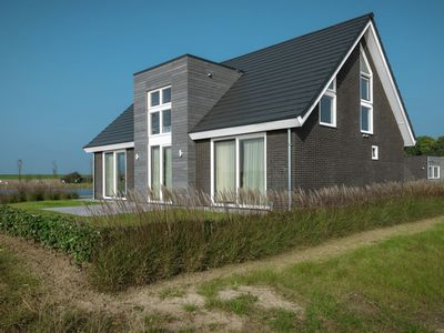 Photo for Beautiful modern house situated on the edge of a pond and near the Oosterschelde