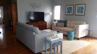"""Open concept Living room with two large sofas and 55""""Smart TV. Sleeper sofa too!"""