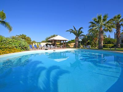 Photo for 4 bedroom Villa, sleeps 12 with Pool, Air Con, FREE WiFi and Walk to Shops