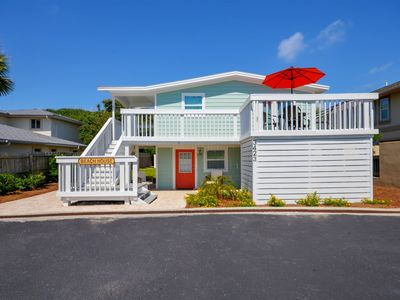 Photo for Three bedroom duplex with partial ocean view and private balcony located across the street from beach.
