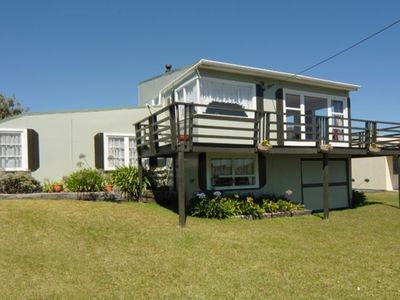 Photo for Well-equipped, spacious classic kiwi bach across from beach