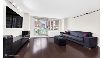 Photo for MIDTOWN EAST APARTMENT ON HIGH FLOOR WITH BALCONY, 24HR DOORMEN, 5 STAR REVIEWS.
