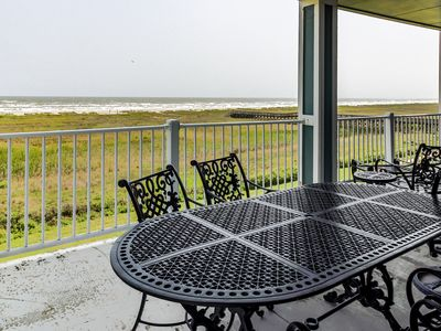 Photo for Dog friendly, oceanside condo next to beach with shared pools/hot tub!