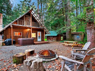 Photo for Charming, updated cabin with wifi, hot tub, near river, forest, and mountains