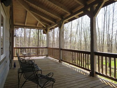 Looking from screened porch down length of back porch