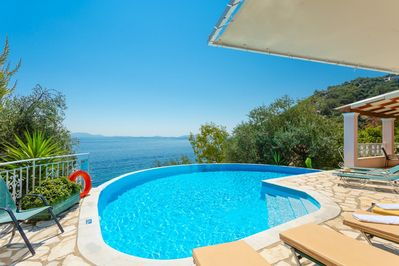 Private infinity pool and terrace with panoramic sea views