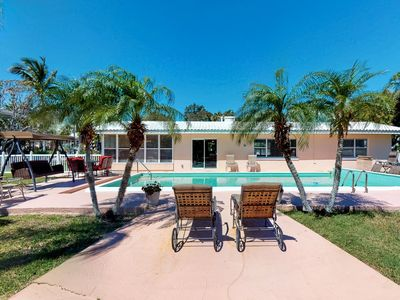 Photo for Canal side home with pool and boat dock!