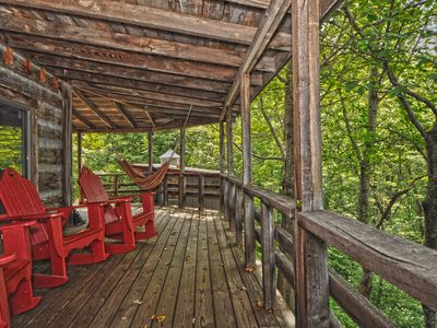 Photo for Rustic log home on picturesque 16-acre wooded, mountain property with pond