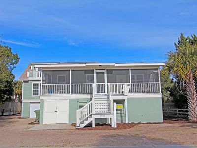Photo for Beautiful elevated home with deck located across the street from the beach