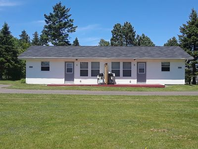 Executive Duplex Cottage #4, with 2 bedrooms and 1 bath. We have added a privacy wall on the patio. The interior has been freshly painted and updated with new décor, beds and a sofa bed.