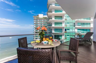 Imagine yourself and your guests on our teak balcony enjoying gorgeous views.