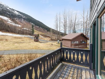 Photo for Charming condo with mountain views & wood stove - ski in/out!