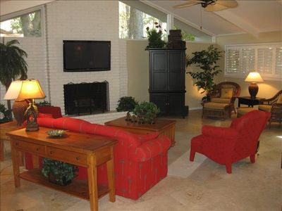 "The living room is open and bright with a 50"" Plasma TV and view of golf course!"