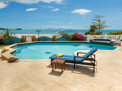 Photo for LUXURY 4 BEDROOM BEACH FRONT VILLA IN JOLLY HARBOUR - PRIVATE POOL