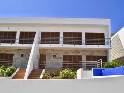 Photo for Stunning luxury villa with infinity pool, 10 min walk to beach