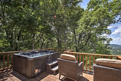 You'll have a beautiful interior, outdoor living spaces, and a private hot tub.